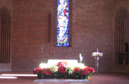 Snowmass Church interior, altar with flowers