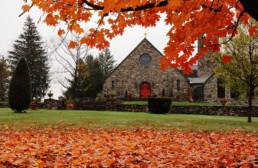 Exterior of St. Joseph Abbey church in fall