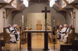 Monks seated in choir in Abbey Church
