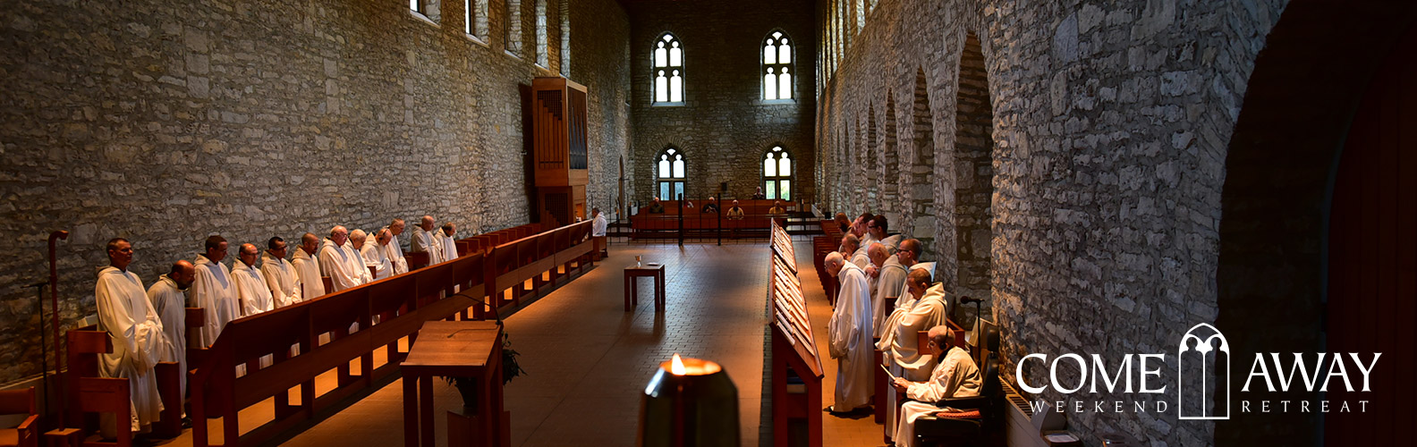 monks in choir in large stone church, text says come away weekend retreat