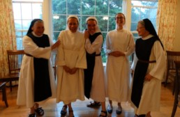 5 Cistercian nuns laughing together