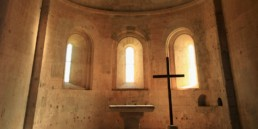 stone church with altar and cross