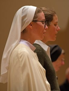 Nuns and female guest singing in choir