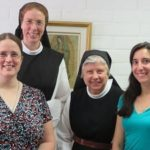 Nuns and retreatant smiling