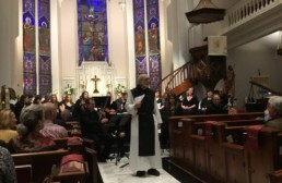 Father Joseph Tedesco speaking in Luthern church at Una Sancta concedrt