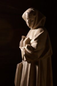 Stature of St. Bernard, holding a image of a Church