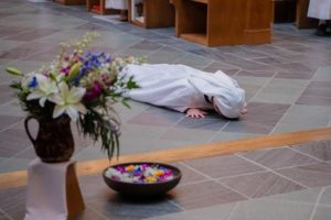 Sr Karla prostrate on floor of St. Mary's Church
