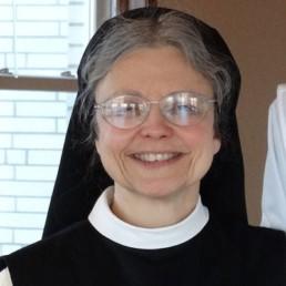Sister Kathleen smiling in habit