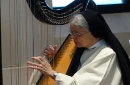 Sr Kathleen, nun playing harp in habit