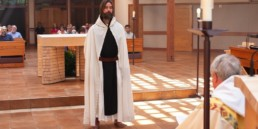 Br. Scott stands before the altar at Guadalupe Abbey